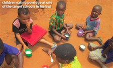 Children eating porridge at one of the target schools in Malawi