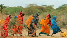 Women from Kabasa Internally Displaced People's camp return from fetching water from the river Jubba