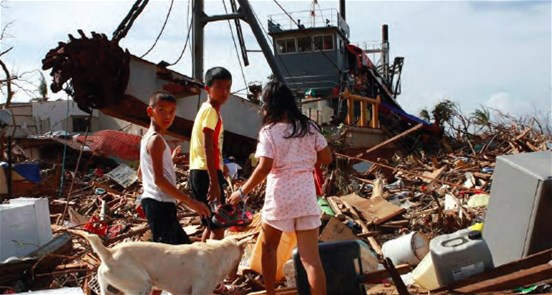 A dredging ship, carried inland by the Typhoon Haiyan, being used as a temporary shelter by more than 20 families