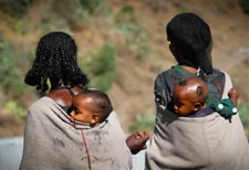 Women with children walking to Bella health post, Amhara region, Ethiopia