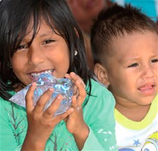 Girl drinking water at Nuevo Terminal Terrestre shelter