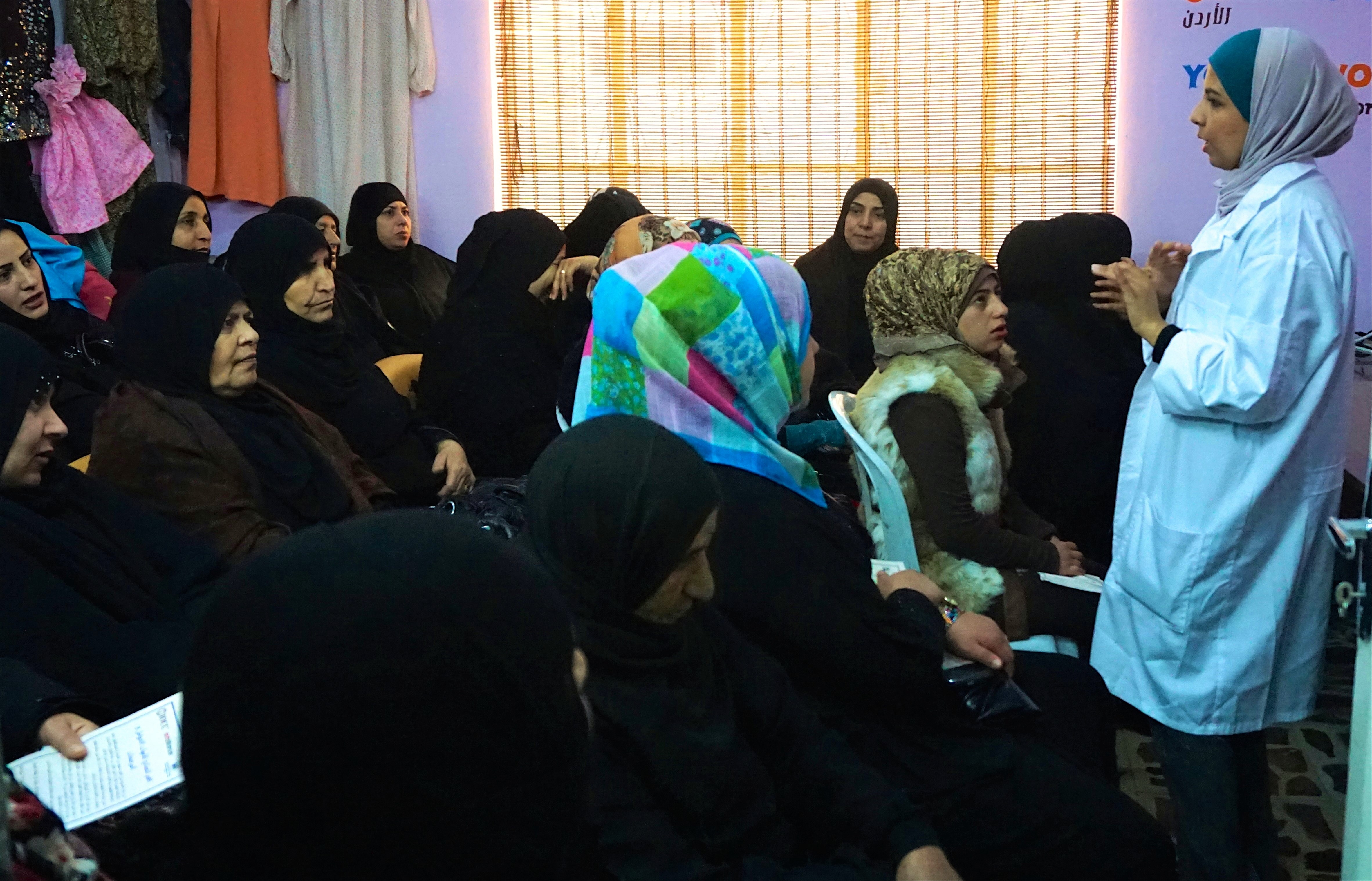 A health educator leads an awareness session for women