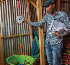 Weighing an infant at a UNICEF-supported outpatient therapeutic centre in Kabasa IDP camp, Dolow, Somalia