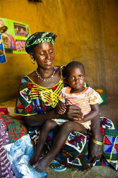 A woman and her child enrolled in a targeted supplementary feeding programme in Damdégou, Burkina Faso, 2012