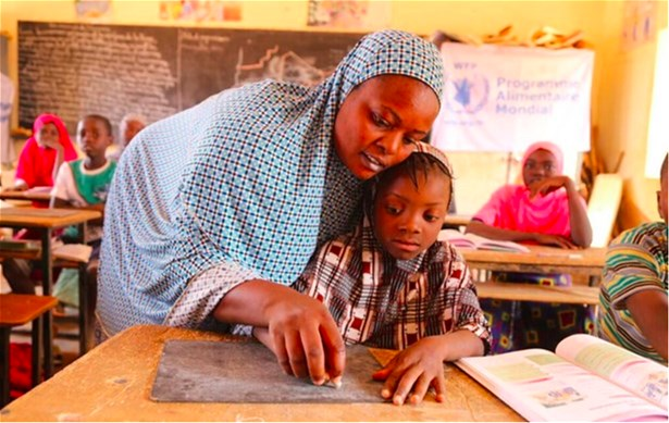 A girl and her teacher in a school in Simiri, Niger, 2017