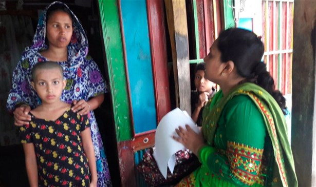 Interview procedure being explained to the a mother, Barguna, Bangladesh, 2017
