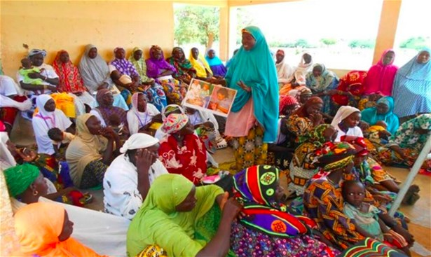 A leader mother explaining what she has learned on exclusive breastfeeding, Banibangou Commune, Niger, 2016