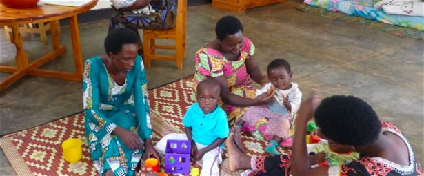 Mothers playing with their babies in the Rwinkwavu Hospital PDC