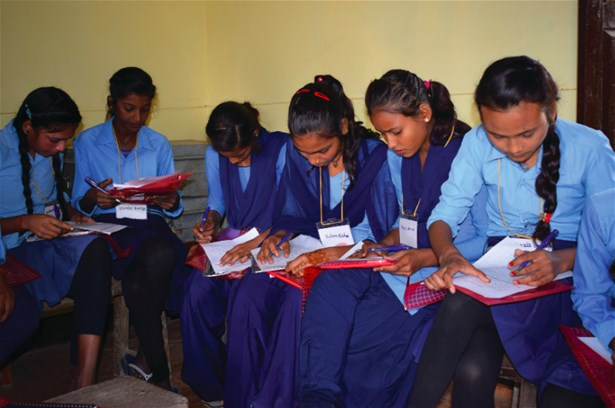 School girls answering a health and nutrition survey for the adolescent programme