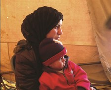 Syrian refugee and her child