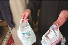A beneficiary of cash assistance in Lebanon holds medications she was able to purchase