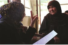 A beneficiary of cash assistance in Lebanon is briefed on the programme