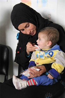 A child is fed RUSF for the treatment of malnutrition (Bekaa valley)