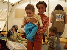 In the ACF tent in Aarsal, Syrian refugees receive support and baby kits with essential items for their children: soap, blanket, baby spoon and cup