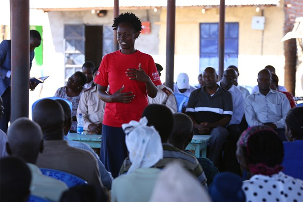 Community Health Volunteer giving a health talk during a community dialogue day
