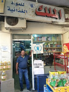 Shopkeeper in a participating shop