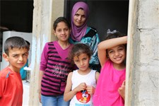 Fatmeh, a 26-year old Syrian refugee mother and her children in Wadi Khaled in North Lebanon