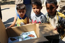 Ahmad (in yellow) and his friends with donated dates distributed by WFP in Bekaa