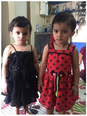 18-month-old twin girls who were admitted to the programme at two months of age and who had reversal of stunting by 27 months of age