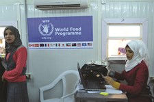 ECHO and WFP provide food vouchers to Syrian refugees in Jordan, Save the Children manages distribution at Zaatari camp.