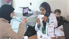 Teaching how to prepare Super Cereal Plus in an Amman clinic