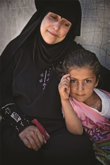 A Syrian woman and her niece in a refugee camp in Jordan