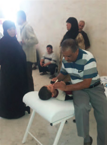 Medical examination at a primary health centre in Aleppo governorate