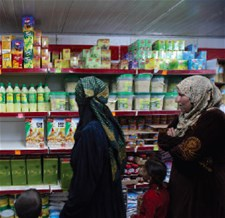 Women doing their own shopping using WFP/TRC electronic food vouchers