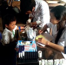 Taking blood samples to assess micronutrient status during a rice fortification trial in Cambodia