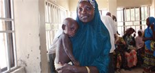 A mother attends with her enrolled infant in a CMAM programme